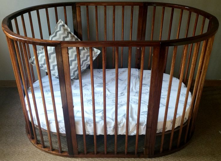 Nuni Infinity cot made from Saligna wood. It can also became a bed if you buy the extension pack