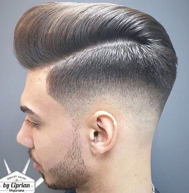 A Mid Fade With A Large Pompadour Mid Fade Haircut Fade Haircut Mens Haircuts Fade