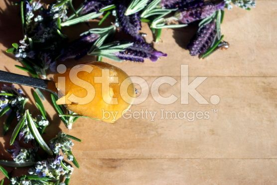 Natural Health Background, A Spoonful of Honey with Herbs royalty-free stock photo
