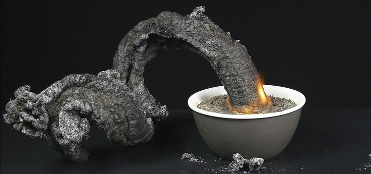 "When the baking soda gets hot, it makes carbon dioxide gas. The pressure from this gas pushes the carbonate from the burning sugar out of the sand, producing the ""black snakes"" Video: ."