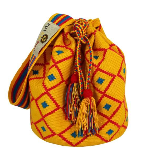 Why fit in when you were born to stand out! One of our beautifully colored, handmade bags can help you do just that. Single thread Putchipuu bucket bag, hand crocheted by the women of the Wayuu people