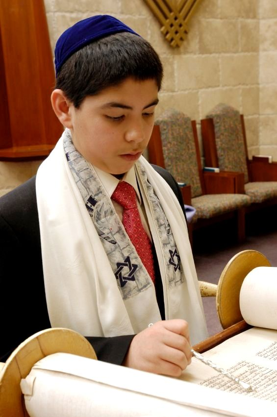 A 13-year-old Jewish boy reads from the Torahfor the first time publicly.