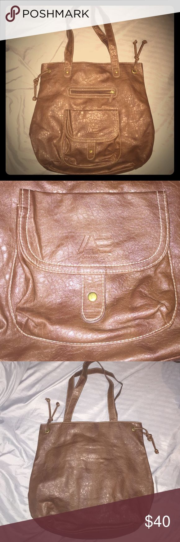 American eagle brown faux leather tote bag This brown leather American Eagle tote bag is in almost perfect condition. Nothing visibly at all wrong with this bag. Two pockets on the front for easy access things. Big compartment on the inside with two small pockets for you their cell phone or whatever you might want to use it for, One small zipper pocket inside and of course the big compartment. This bag has a Velcro closure pretty much perfect. American Eagle Outfitters Bags Totes
