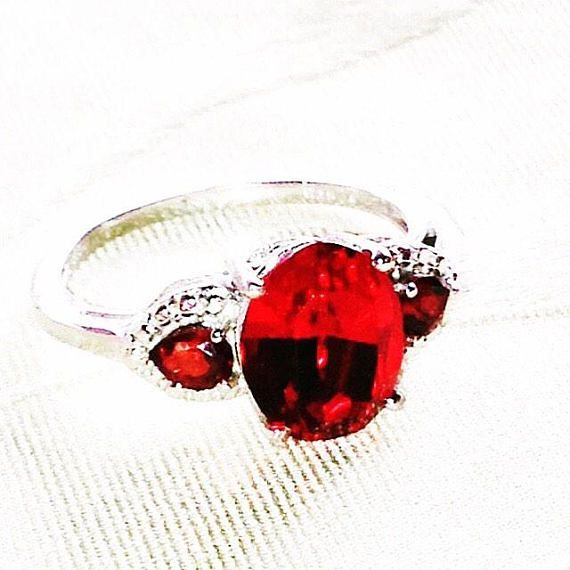 This beautiful and timelessly stylish ring features garnets and crystals in platinum over sterling silver, size 8, resizable. About garnet. Garnet is a gemstone of passion, sensuality, sexuality, romantic love, intimacy, positive thoughts, energy, past life recall, inspiration,