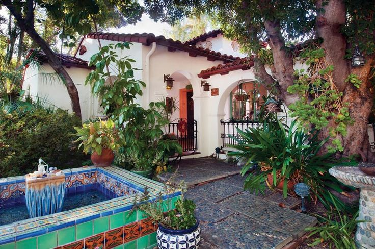 hacienda courtyards | homeowner designed the traditional Spanish fountain in the courtyard ...