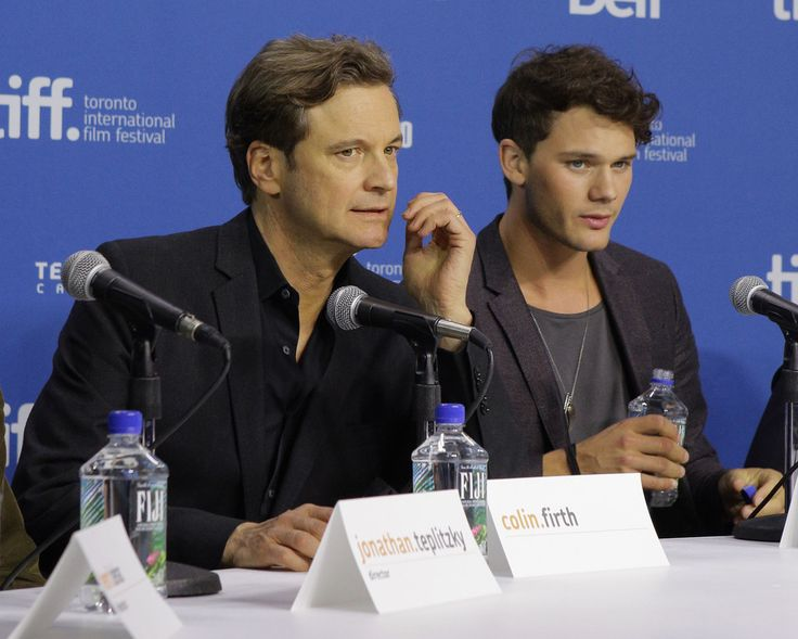 """Colin Firth Photos Photos - Actor Colin Firth and actor Jeremy Irvine speak onstage at 'The Railway Man' Press Conference during the 2013 Toronto International Film Festival at TIFF Bell Lightbox on September 7, 2013 in Toronto, Canada. - """"The Railway Man"""" Press Conference - 2013 Toronto International Film Festival"""