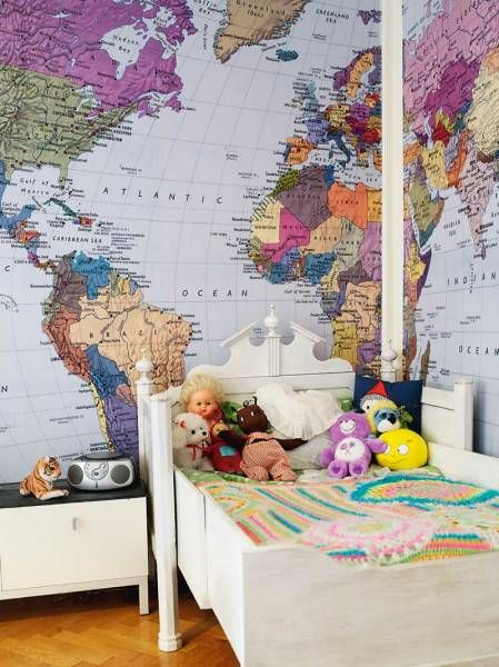 I saw this once in a house. It was a huge map of Africa on a kids wall. I think its brilliant...and I would even have it on my wall, in my workspace maybe.