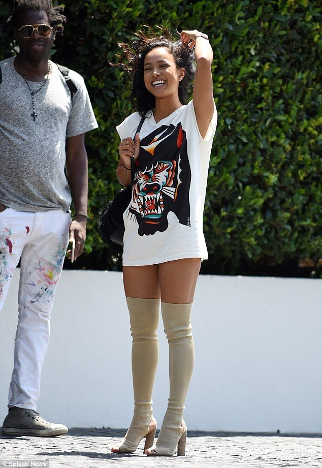 Pint sized goddess!Karrueche Tran showed off a lot of leg in a pair of Yeezy boots on Tuesday in WeHo