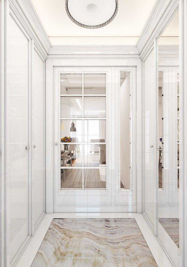 Aranżacja wnętrza hallu z kamienną posadzką w rezydencji pod miastem. Klasyczne fronty szafy nawiązują do kolorystyki kamienia i odbijają się w lustrach powiększając wnętrze.