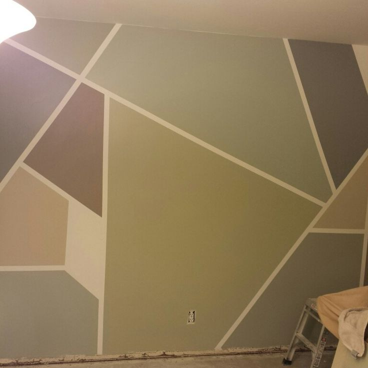 frog tape geometric home gym wall paint project before baseboards went in - Paint Designs On Walls With Tape Ideas