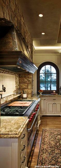 Mediterranean kitchen…mix of darks (stove and fur down and lights with the cabinets)