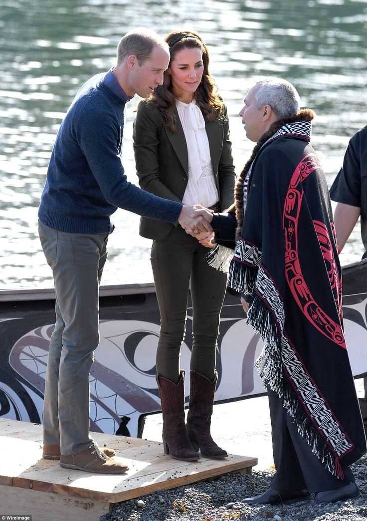 William and Kate stepped out the canoe before greeting elders, children and the chief in Haida Gwaii