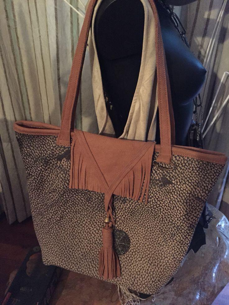 Reversible Leather bags made in Kenya by Italian designer. Lining in kitenge