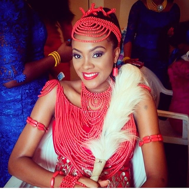 The beautiful Igbo bride Ifeoma at her Igba Nkwu/traditional Igbo Nigerian wedding. She is so beautiful in her coral bead jewelry. Source: Bella Naija
