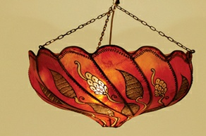 I think this lampshade would really add a warm atmosphere to the home.  What do you think?  It's hand painted by a Berber woman so it's going to be unique.