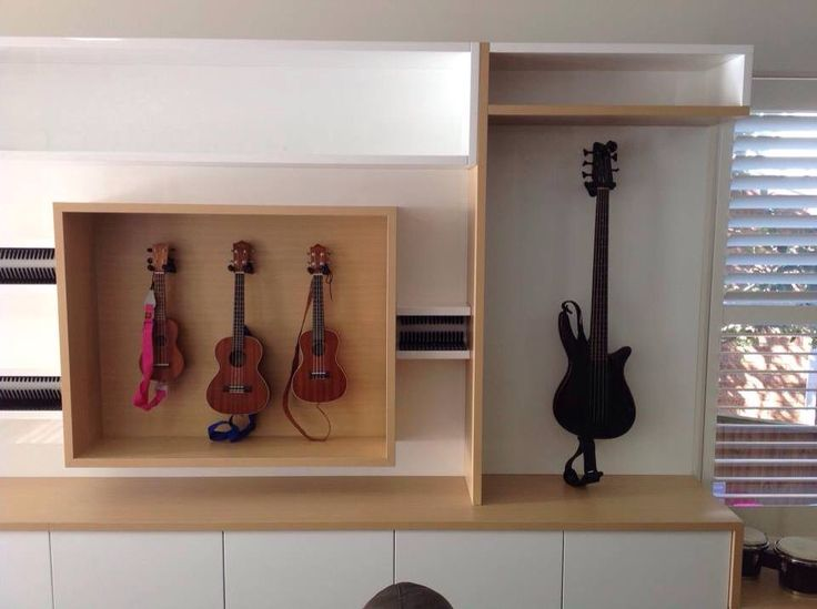 Music room cabinetry, with high gloss polyurethane finish with finger pull detail and Tuross Oak timber print melamine. Call Steve @ Creative Space Construction to discuss your next joinery project 0404789704