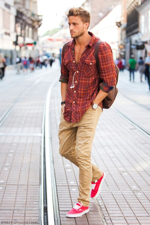 Shop this look for $106:  http://lookastic.com/men/looks/orange-longsleeve-shirt-and-brown-backpack-and-khaki-chinos-and-neon-pink-low-top-sneakers/1109  — Orange Plaid Longsleeve Shirt  — Brown Backpack  — Khaki Chinos  — Neon Pink Low Top Sneakers