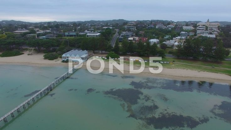 Sideways flight and descend towards Sorrento Long Pier facing The Baths - Stock Footage | by gregbrave