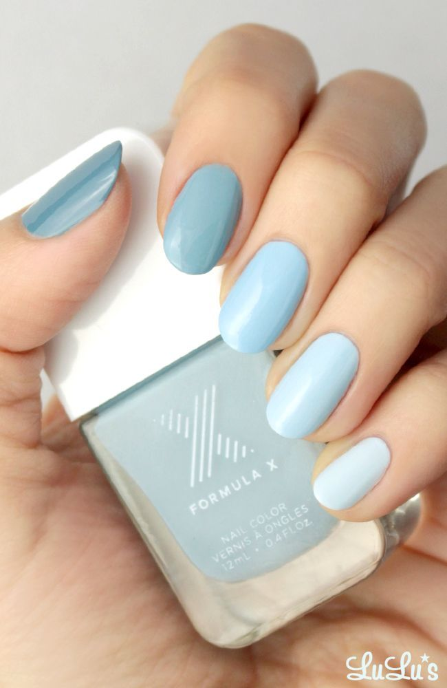 Light blue nails. Different shades of the same color. Inspiration to get original nails for this summer. Trendy nails colors. Plain simple design, not nailart at all.