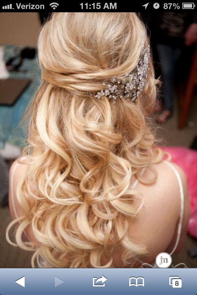 Wedding hair half-up... I love the positioning of the hair piece on this one .