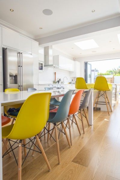 Very colourful dining chairs in Londoner Melinda's home. She has a lot of natural light in her kitchen. You can see more of her home on MADE Unboxed.