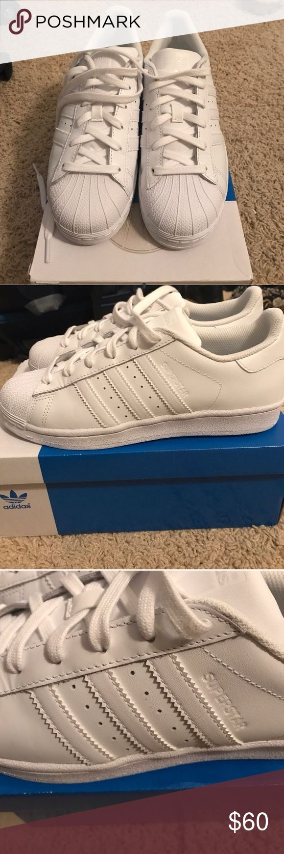 All white Adidas Superstars A pair of all New white adidas superstars in great condition. They're children size5.5 & fit a size7.5 in woman. They've never been worn cuz I bought & didn't fit . I'll ship with original box . adidas Shoes Sneakers