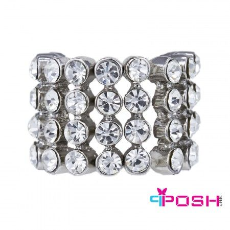 "Christel - Ring.                                          Stretch ring - Silver tone metal - Four rows of white crystals - Dimension: 0.79"" width - Stretch ring will fit most sizes.                                                                                                                                   POSH by FERI - Passion for Fashion - Luxury fashion jewelry for the designer in you."