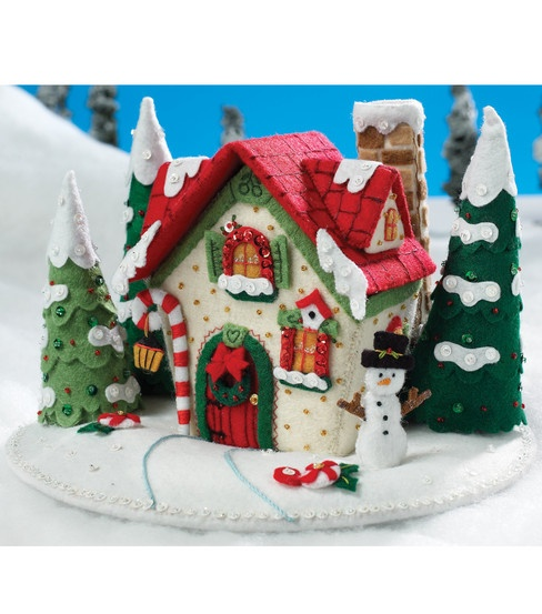 Mary Engelbreit kit: Snow cottage. A work in progress for a long time, but now finished. And it look awesome