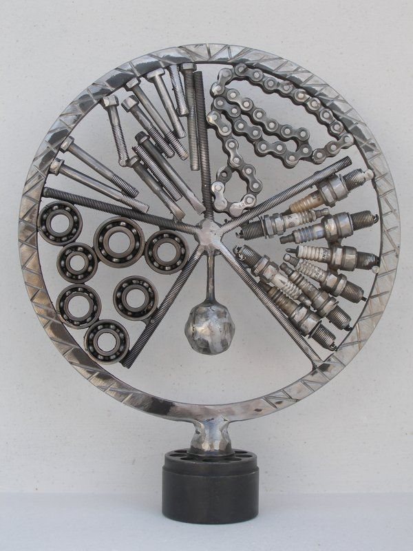 Circle metal sculpture handmade by Giannis Dendrinos