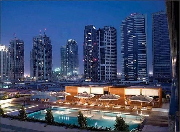 OopsnewsHotels - Radisson Blu Residence Dubai Marina. Situated in Dubai, Radisson Blu Residence Dubai Marina is a short walk from Dusit Residence and provides a swimming pool, a rooftop terrace and a sauna. Boasting views of Dubai Marina, it also offers a wide range of amenities, including free wireless internet, private parking and a free shuttle service.