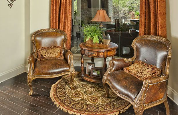 leather chairs, wood table, chandelier & round oriental place rug