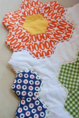 "How to Finish Your Hexagon Quilts ~ Nice tutorial on how to finish/""bind"" your hexagon quilt.  I really like these instructions and so EASY to do!  She explained very well and on what do and has pictures for you to follow with...very clever and great for Beginners."