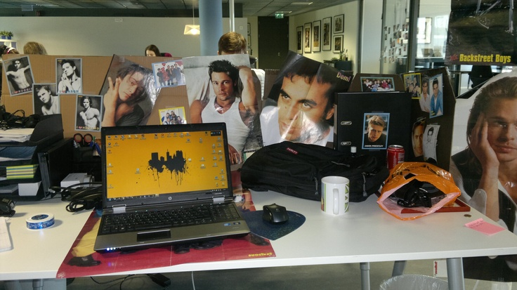 Office prank number 2. Office desk covered with boy band posters, how lovely. #office #pranks