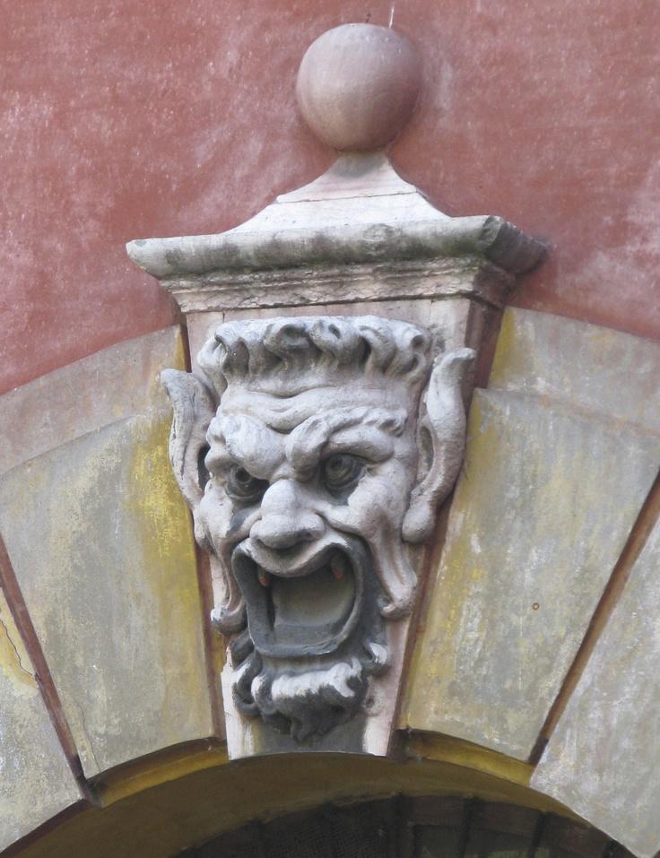 Gargoyle keystone over doorway, Modena
