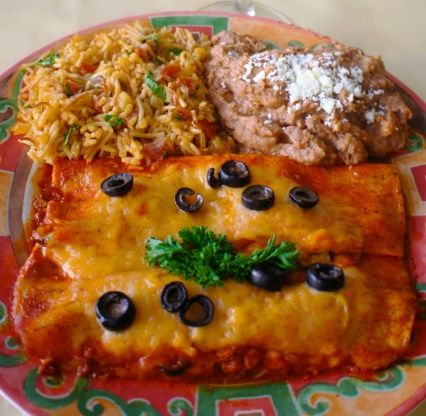 Wonderful flavors of Mexico, full of tender shredded beef and creamy cheddar cheese, and this sauce is mild and awesome! But you can crank up the heat by adding more cayenne pepper to your liking. http://www.food.com/recipe/authentic-mexican-beef-enchilladas-523302