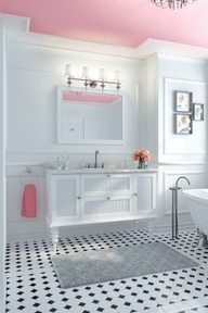 Pink bathroom ceiling, with beautiful black and white tiles.