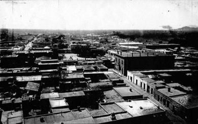 (above) An 1890 bird's-eye view shows Tucson's traditional urbanism. The private outdoor space typically found at the center of each block can be seen in the foreground. The continuous height and scale and the inherent density of the urban fabric define the void of the public plaza and the public street.