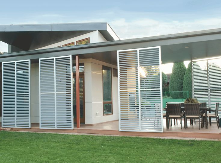 outdoor dining room with sliding metal shutters