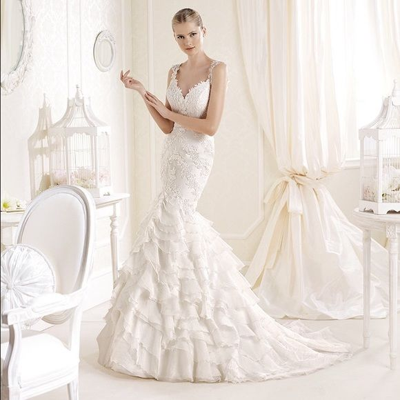 I just discovered this while shopping on Poshmark: **PRICE DROP*** NWT LA SPOSA WEDDING GOWNNWT. Check it out!  Size: 10