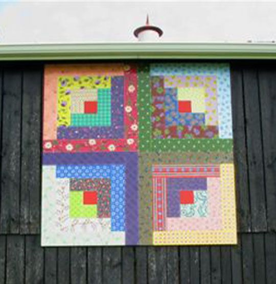 """Loretto Log Cabin Quilt Square, """"Clothesline of Quilts"""" trail running through Kentucky, Ohio, and Tennessee."""