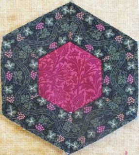 Barbara Brackman's MATERIAL CULTURE, Upton by Bettina Havig I don't think Bettina and Becky saw each other's blocks but they fussy cut the same Vine Tapestry for the outside ring.