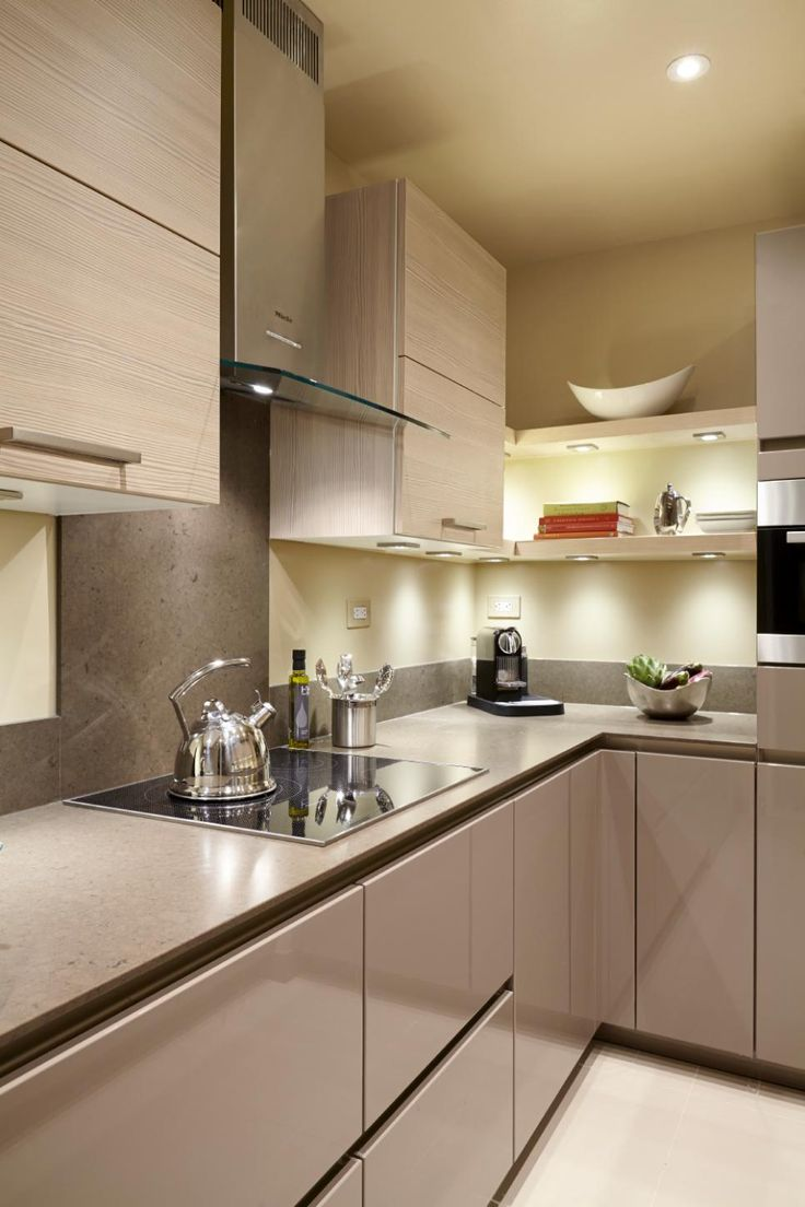 The thin, ½ inch countertops and the handle-free concept help continue the simple, horizontal, linear design of the kitchen.