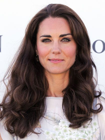 To create the big curls at the bottom, use a two-inch curling iron to clamp down on the ends of the hair, then roll it up, holding the iron horizontally.