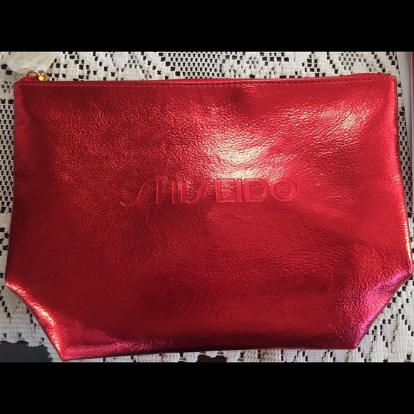 Shiseido make up kit/pouch Nwot red shiseido make up bag/kit. Other