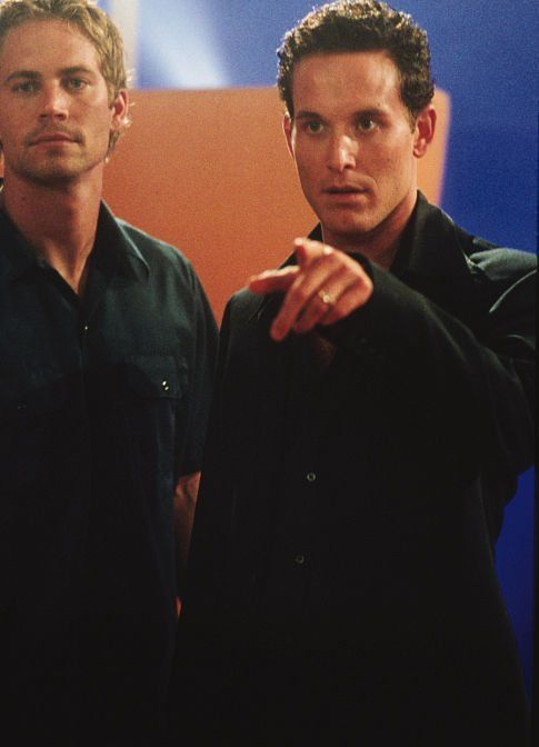 Cole Hauser and Paul Walker in 2 Fast 2 Furious / 2003