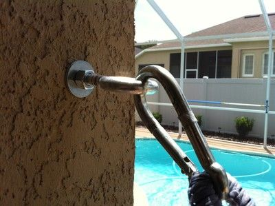 """Hammock hook - Here is the supply list:  2 1/2"""" x 6"""" eye bolt w/ nut and 2 fender washers, 2 1/2"""" x 2"""" concrete drop-in anchors, 2 3/4"""" spring links (to hook between the eye bolt and the hammock eye - you may not even needs these or might have something already that could hook them together), 1 5/8"""" x 6"""" masonry drill bit. I drilled a 3"""" deep hole, cleaned out hole, put on nut, then washers then screwed on drop-in anchor until it was about ready to expand. Then I inserted..."""
