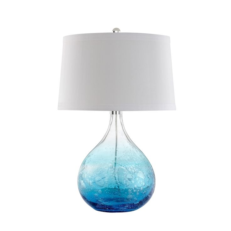 The Ocean bulb-shaped table lamp has rich hues of blues with a bubble design paired perfectly with a white linen round hardback shade with self-banding.