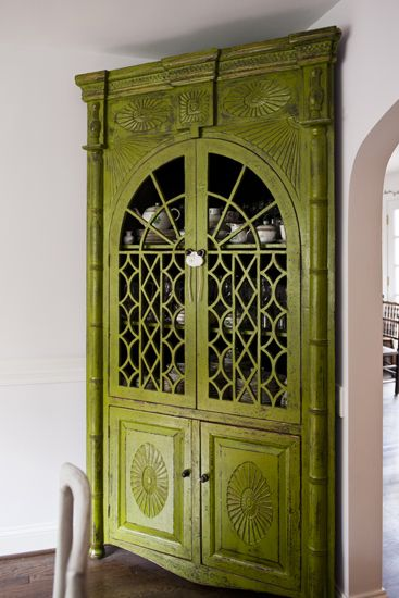 Love the color and patina of this corner cabinet. The fretwork on the cabinet front has wonderful pattern potential.