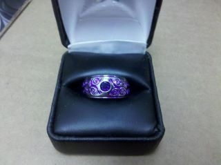 Stunning color match between an round amethyst, and a shifting purple anodize, carved titanium ring - This one is a show-stopper !