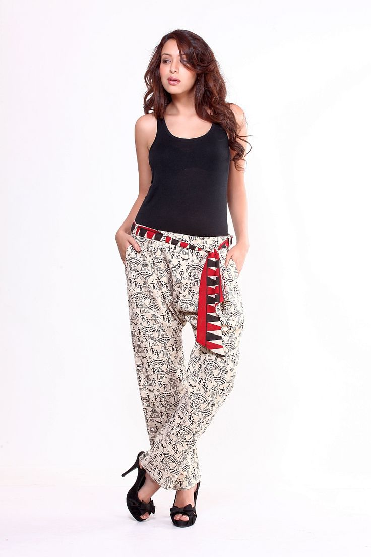 Harem pants are versatile as they can be worn both with Indian wear and with Western wear. These comfortable cotton harem variation pants are great for the summer as they ligh weight. A red colourful show tie-belt adorns the waist highlighting the pants and giving them an extra edge.  Fabric/Material: Cotton